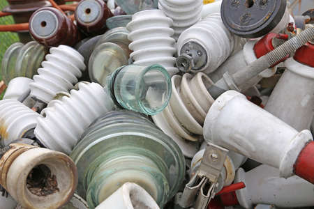 old ceramic insulators in an old dump material