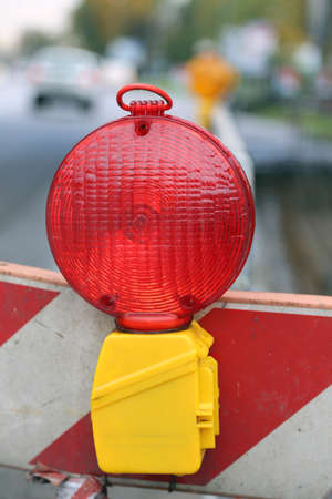 roadworks: red lamp to signal roadworks and road works Stock Photo