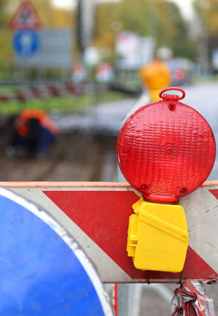 red lamp to signal roadworks and road works in progress photo
