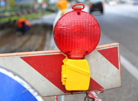 roadworks: red lamp to signal roadworks and road works in progress