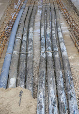 power cables: many underground pipes corrugated for optical fiber and power cables