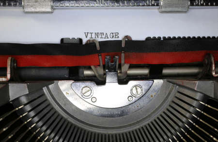 the publisher: typewriter with written VINTAGE in black ink Stock Photo