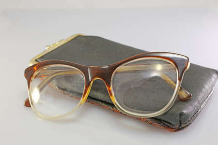 crystalline lens: old glasses of an old man with leather case Stock Photo