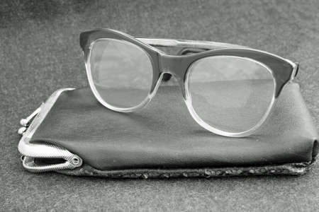 crystalline lens: an elderly old glasses with leather case