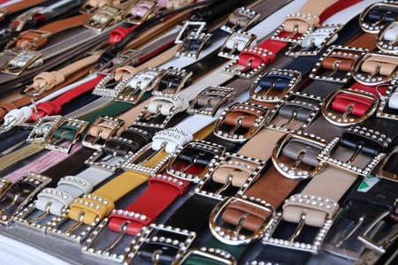 complement: many mens leather belts and shoes for sale at flea market