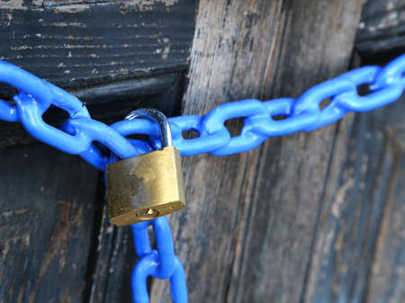 not open: padlock with a blue chain and  the door closed Stock Photo