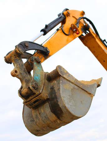 roadwork: huge bucket of a bulldozer during the roadworks