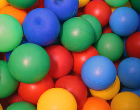 plastic colored balls with vivid colors into a pool of balls