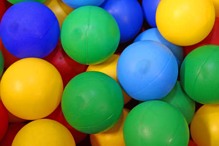 blue green red yellow colored spheres into a pool of balls