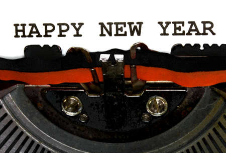 Typewriter Types HAPPY NEW YEAR Closeup black ink