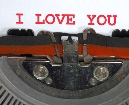 Typewriter Types I LOVE YOU Closeup with red ink Stock Photo