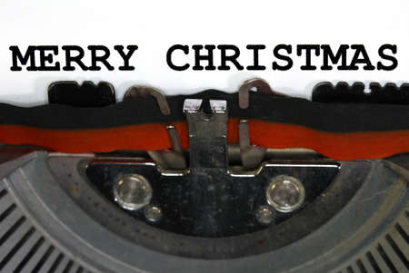 very old Typewriter Types MERRY CHRISTMAS  Closeup with black ink