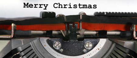 very old Typewriter Types MERRY CHRISTMAS  Closeup Stock Photo