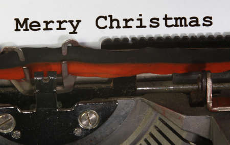 very old Typewriter Types MERRY CHRISTMAS  Closeup photo