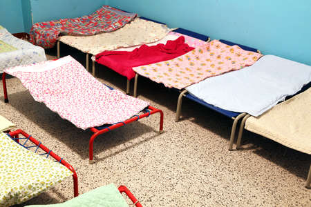 dormitory: dormitory with cots to sleep nursery children