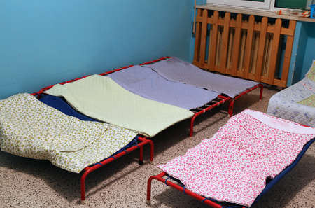 dormitory: dormitory with little beds for children in the early childhood school