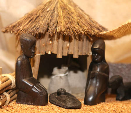 Nativity scene with Holy Family in a manger African Style