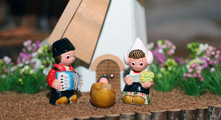 presepe: statues of the Nativity scene with Holy Family in Dutch style and a windmill