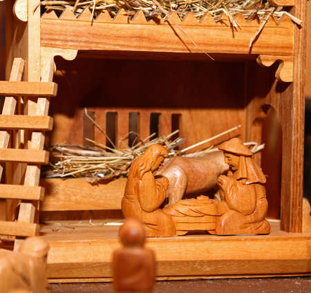 presepio: wooden statues of the Nativity scene with Holy family