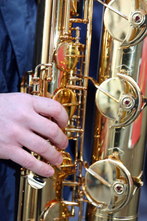 youngs: Youngs hand playing with sounds experienced golden saxophone