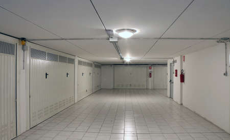 car park interior: Gates of underground garages to a large condominium in the popular area of the city Stock Photo