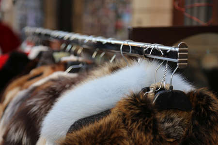 retro fashion: furs and used clothes for sale at flea market