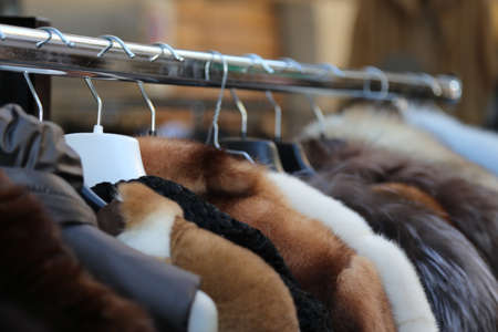 used clothes: furs and used clothes for sale at flea market