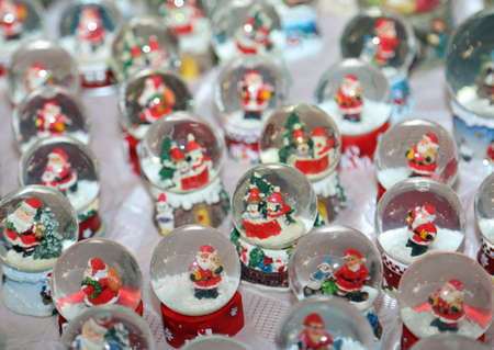 Christmas balls with water inside and Santa Claus as Christmas decoration photo