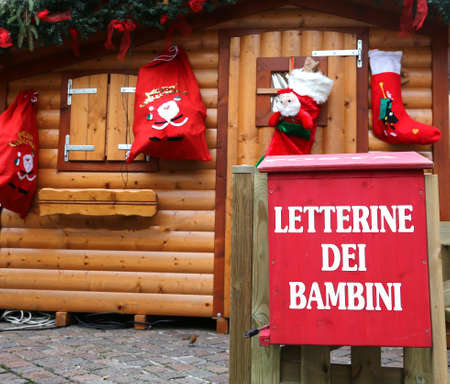 Santas cottage with the red mailbox to post the letters of children