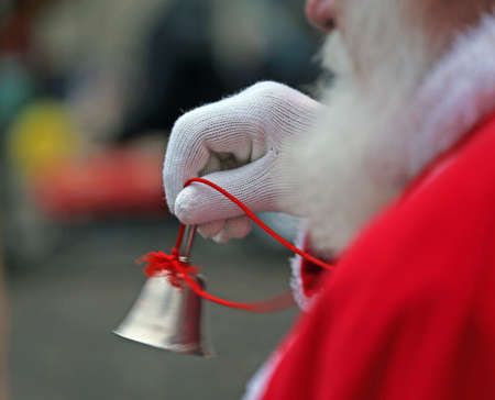 Silver played little Bell from Santa Claus with white glove Stock Photo