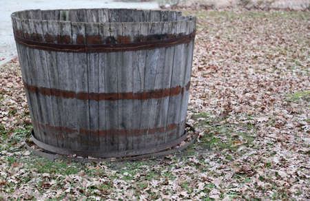 old barn in winter: old wooden tub to pick the grapes during the harvest and wine making