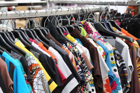 retro and vintage clothes of many colors for sale at flea market