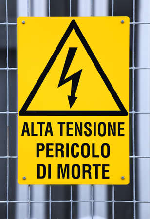 fatal: sign with potentially fatal HIGH VOLTAGE in an industrial plant Stock Photo
