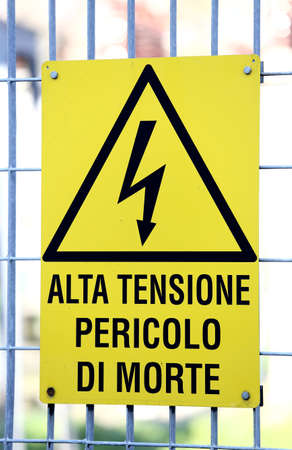 fatal: yellow sign with potentially fatal HIGH VOLTAGE in an industrial plant Stock Photo