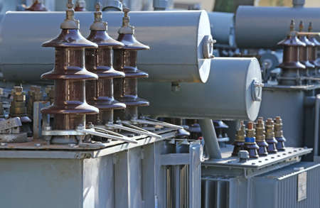 electrics: piles of old voltage transformers in a landfill of electrical equipment to be recycled