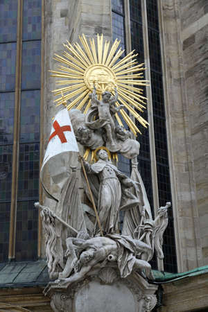 saint stephen cathedral: detail of the statue on the St. Stephens Cathedral of vienna in austria with flag Stock Photo
