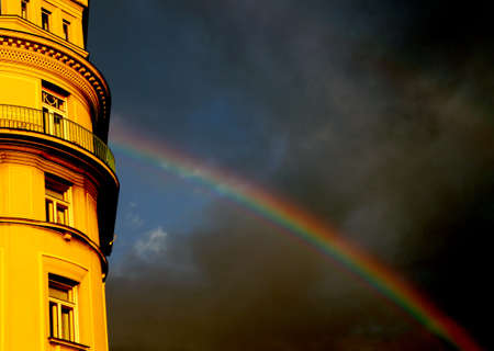 enters: Double Rainbow that enters in the European building after the storm Stock Photo