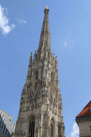 saint stephen cathedral: high Bell Tower of St. Stephens Church in Vienn Stock Photo