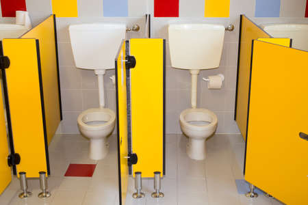water closet: small bathroom of a preschool for children with water closet Stock Photo