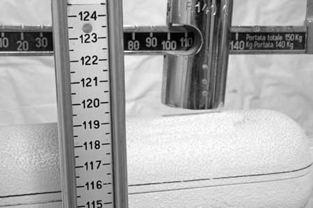 measure height: old scale with the meter to measure the weight and height of patients