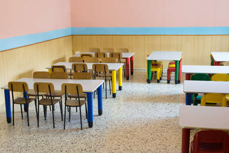 Lunchroom Of The Refectory Of The Kindergarten With Small Benches And Small  Colored Chairs Stock Photo