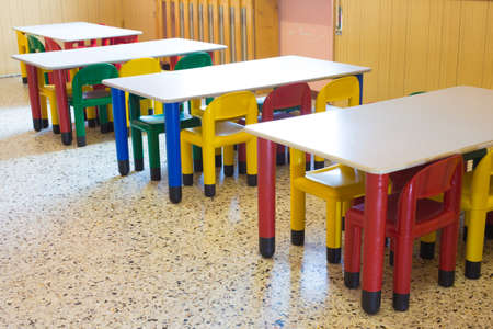 kindergarten with small benches and small colored chairs photo
