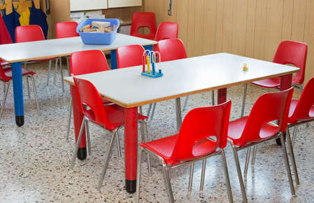 Bon Classroom Nursery With Red Chairs And Small Desks For Children Stock Photo    35104679