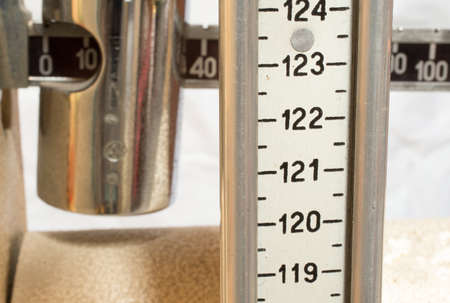 old scale with the meter to measure the weight and height of patients
