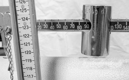 measure height: antique scale numbers with the meter to measure the weight and height of patients