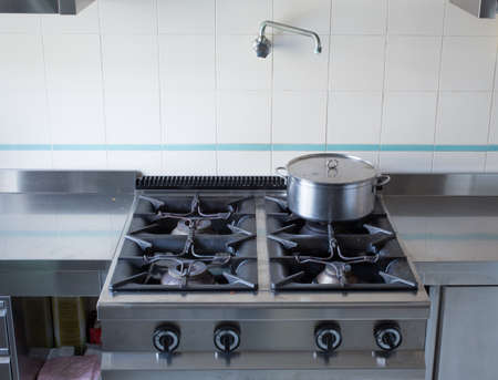large pot over the stoves gas stainless steel industrial kitchen photo