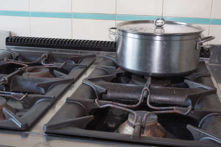 steel large pot over the stove of industrial kitchen photo