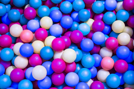 the series: series of colorful plastic balls in the pool for children Stock Photo