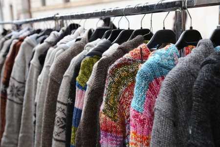 openair: sweaters and vintage clothes for sale in open-air flea market