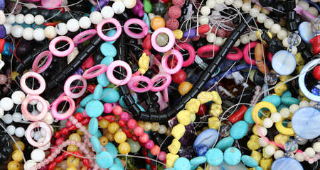 thousands: thousands of colorful necklaces  on sale in the market stall Stock Photo